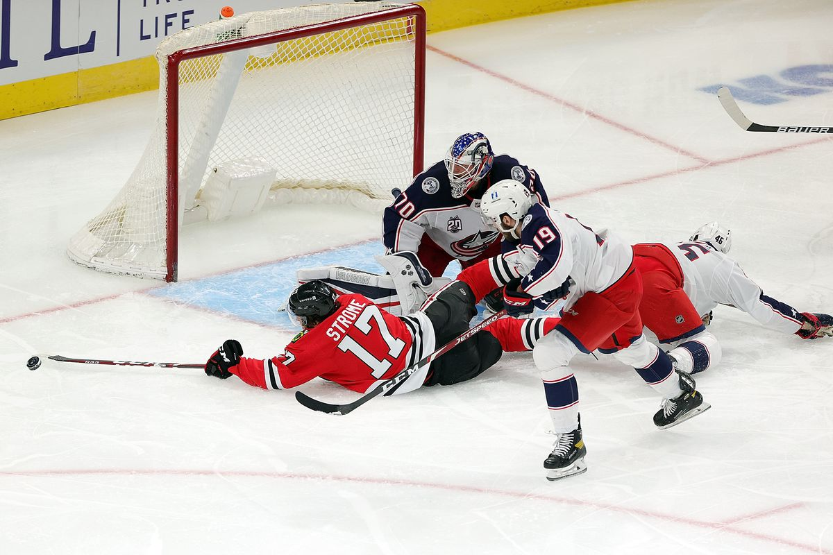 Dylan Strome of the Chicago Blackhawks attempts a shot against Joonas Korpisalo of the Columbus Blue Jackets during the first period at the United Center on January 29, 2021 in Chicago, Illinois.