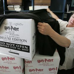 """Anne Holman, manager at The King's English Bookstore, keeps her boxes of """"Harry Potter and the Deathly Hallows"""" under wraps in 2007. The King's English was one of the first bookstores in Utah to sell the Harry Potter books, which is celebrating the 20th anniversary of the U.K. publication of the first book in the series on June 26."""