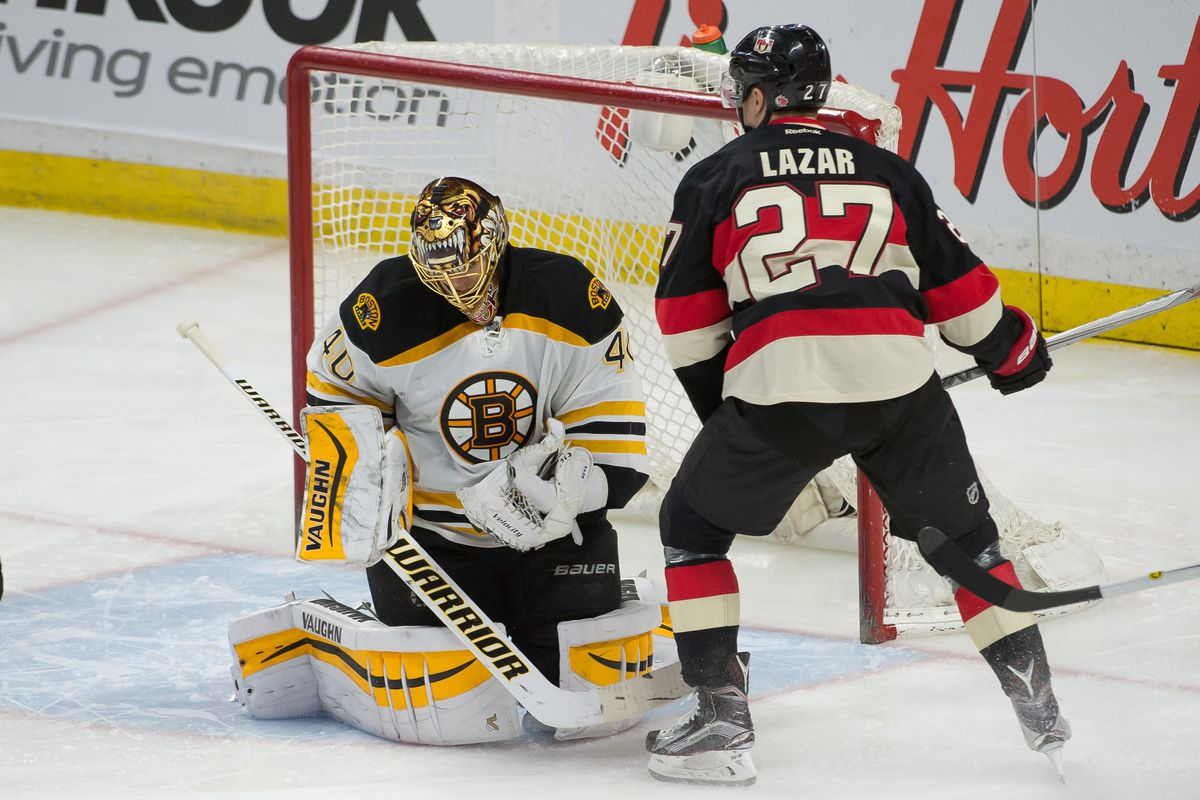 Lazar thinks about taking a bite out of Rask's mask.