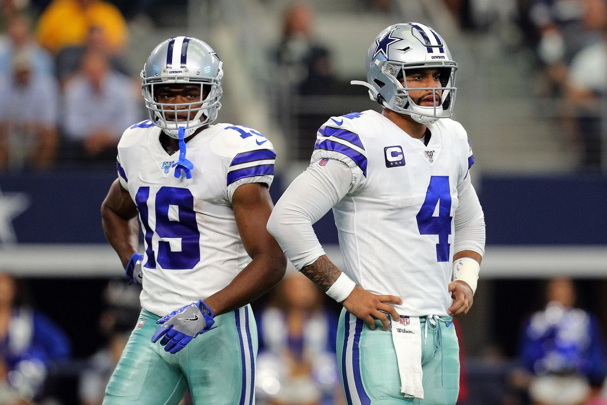Amari Cooper and Dak Prescott of the Dallas Cowboys stand on the field in the first quarter against the Green Bay Packers at AT&T Stadium on October 06, 2019 in Arlington, Texas.