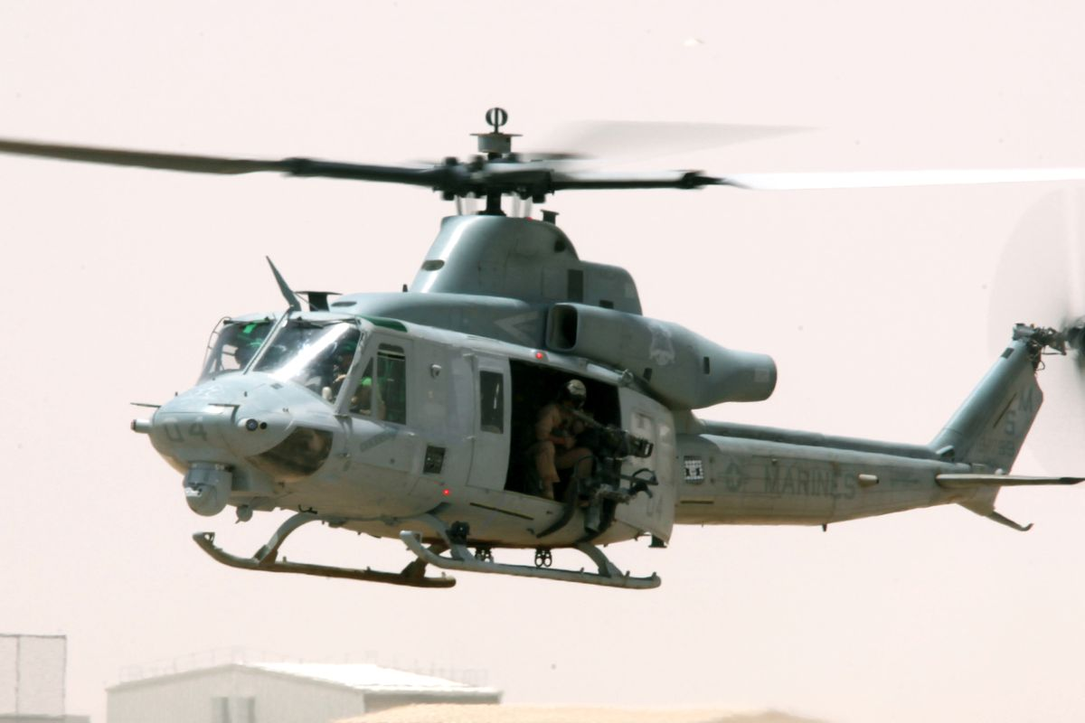 """a UH-1""""Huey"""" helicopter lands"""