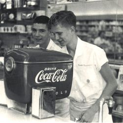 Coca-Cola vending machines, soda dispensers, delivery trucks, and bottles