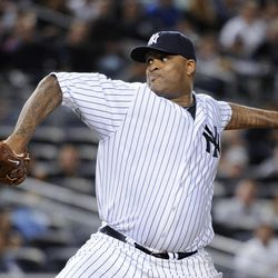 New York Yankees starting pitcher CC Sabathia throws to an Oakland Athletics batter during the second inning of a baseball game Friday, Sept. 21, 2012, at Yankee Stadium in New York.