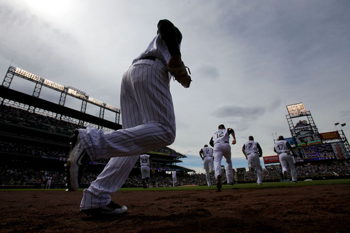 DENVER - APRIL 25:  The Colorado Rockies take the field as they host the Florida Marlins at Coors Field on April 25, 2010 in Denver, Colorado.  (Photo by Doug Pensinger/Getty Images)