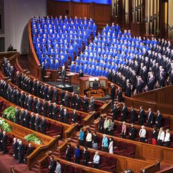 The choir and those on the stand, stand and sing during the Saturday morning session of the 183rd Semiannual General Conference for the Church of Jesus Christ of Latter-day Saints Saturday, Oct. 5, 2013 inside the Conference Center.