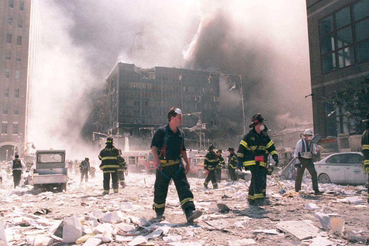 Firefighters work near Ground Zero on Sept. 11, 2001.