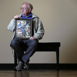 Tom Paquin of North Bennington, Vt., poses with a1950 Saturday Evening Post illustration by Norman Rockwell for which he modeled at the Bennington Museum on Friday, Sept. 28, 2012, in Bennington, Vt. (AP Photo/Mike Groll)
