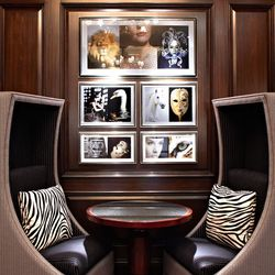 zebra print pillows and funky artwork add to the new decor.