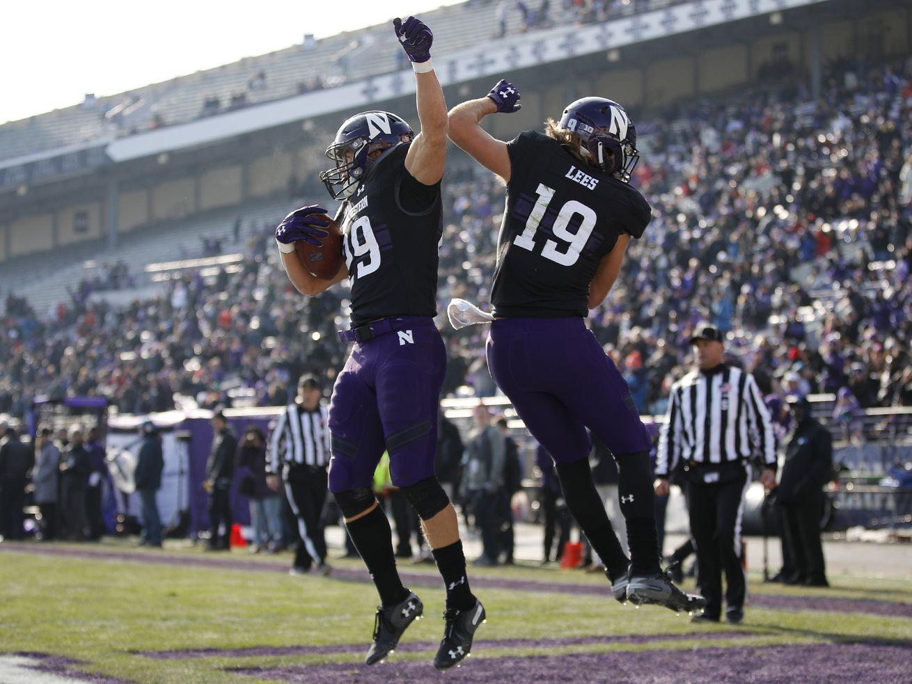 Northwestern's Tyler Haskin, left, celebrates his touchdown against Massachusetts with teammate Riley Lees.