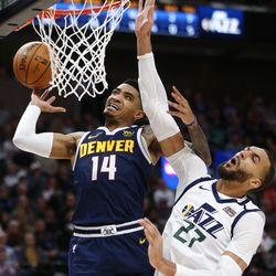 Denver Nuggets guard Gary Harris (14) loses the ball at the hoop with Utah Jazz center Rudy Gobert (27) defending as the Utah Jazz and the Denver Nuggets play an NBA basketball game at Vivint Arena in Salt Lake City on Wednesday, Feb. 5, 2020. Denver won 98-95, giving the Jazz their fifth straight loss.