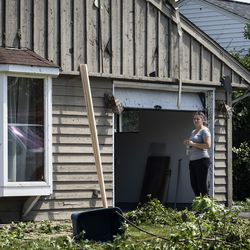 Jamie Kasper stands outside her home on Evergreen Lane near Chestnut Avenue in Woodridge after a tornado ripped through the western suburbs overnight, Monday morning, June 21, 2021.