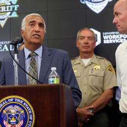 Salt Lake County District Attorney Sim Gill discusses Operation Rio Grande during a press conference at the state Capitol in Salt Lake City on Monday, Aug. 14, 2017. At right is Lt. Gov. Spencer Cox.