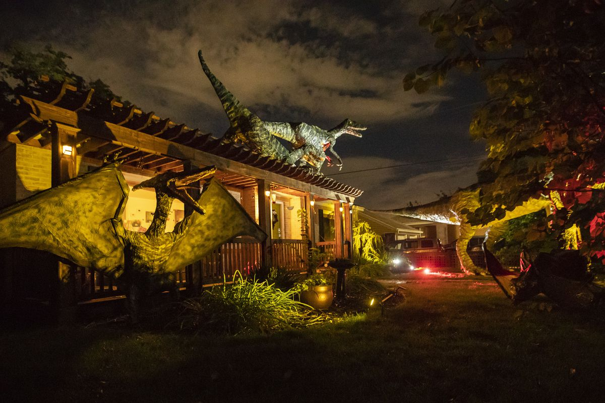 Dinosaurs created by Ammon Smith for Halloween are pictured in the front yard of his home in Salt Lake City on Wednesday, Oct. 3, 2018.