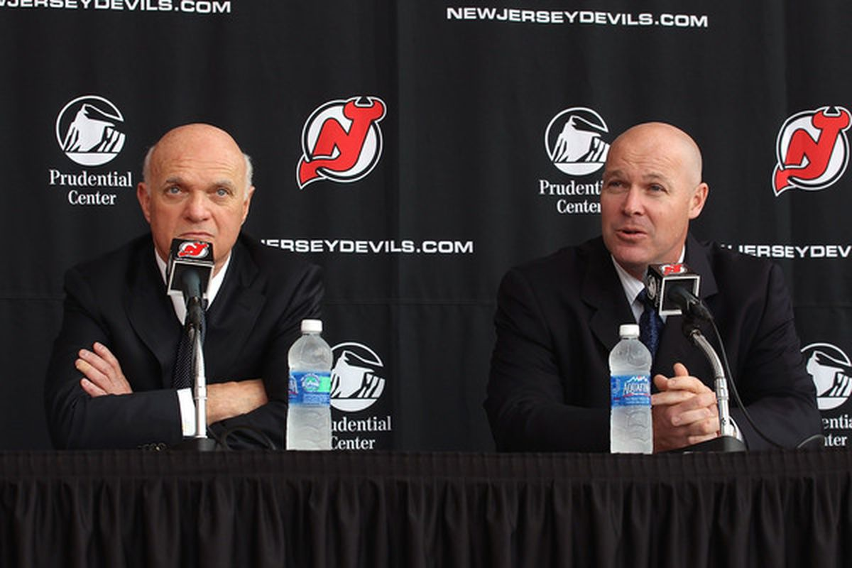 Lou Lamoriello and John MacLean in happier times, discussing barbers.