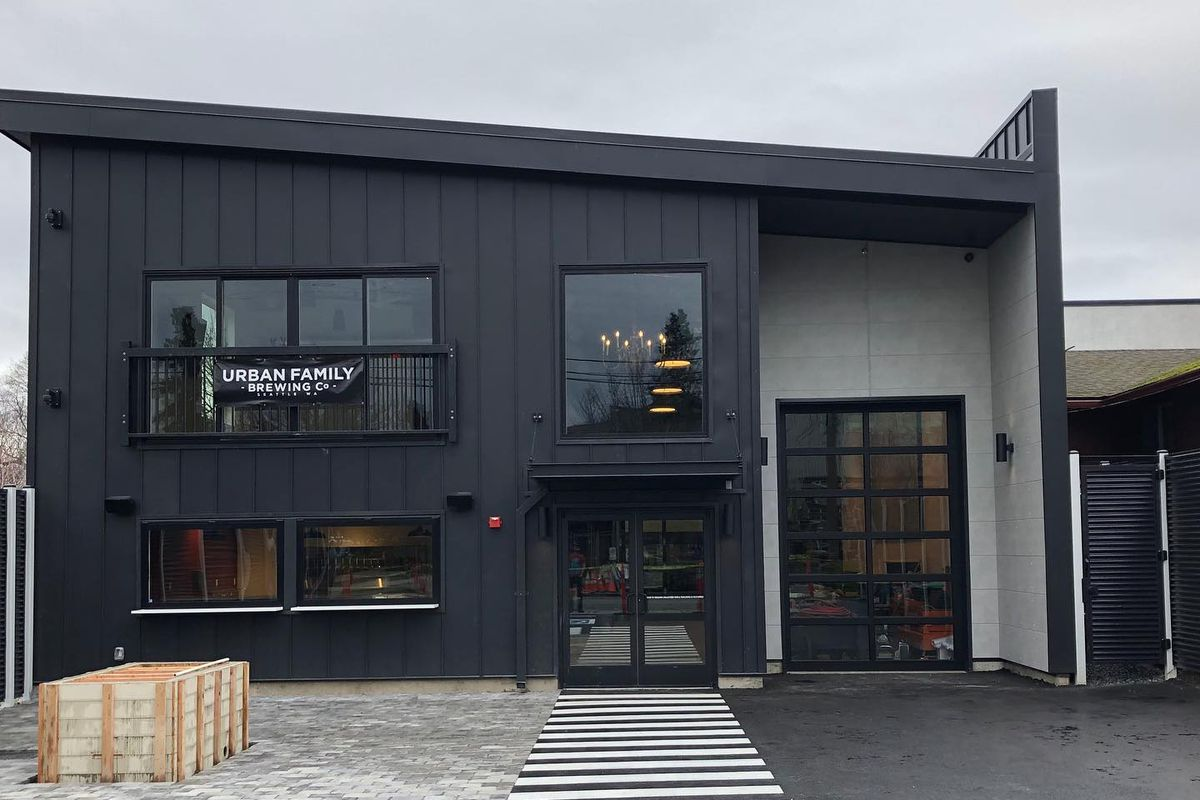 The outside of Urban Family Brewing's new Ballard taproom with gray tones and a slanted roof.
