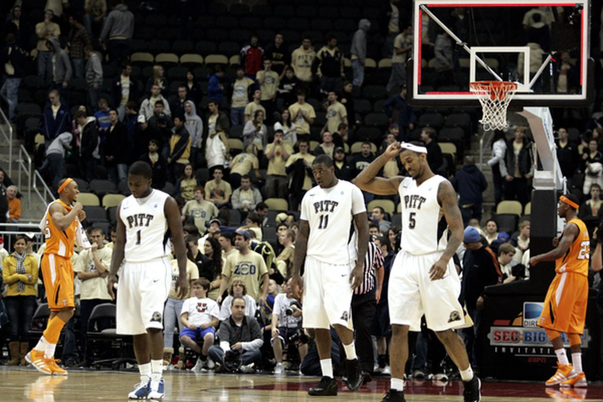 Travon Woodall #1 Dante Taylor #11 and Gilbert Brown #5 of the Pittsburgh Panthers walk off the court dejected after falling to the Tennessee Volunteers.  (Photo by Justin K. Aller/Getty Images)