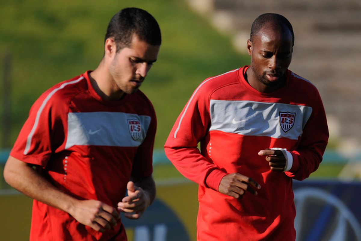 PRETORIA, SOUTH AFRICA - JUNE 13:  DeMarcus Beasley (R) and Benny Feilhaber of US national football team warm up during a training session at Pilditch Stadium on June 13, 2010 in Pretoria, South Africa.  (Photo by Kevork Djansezian/Getty Images)