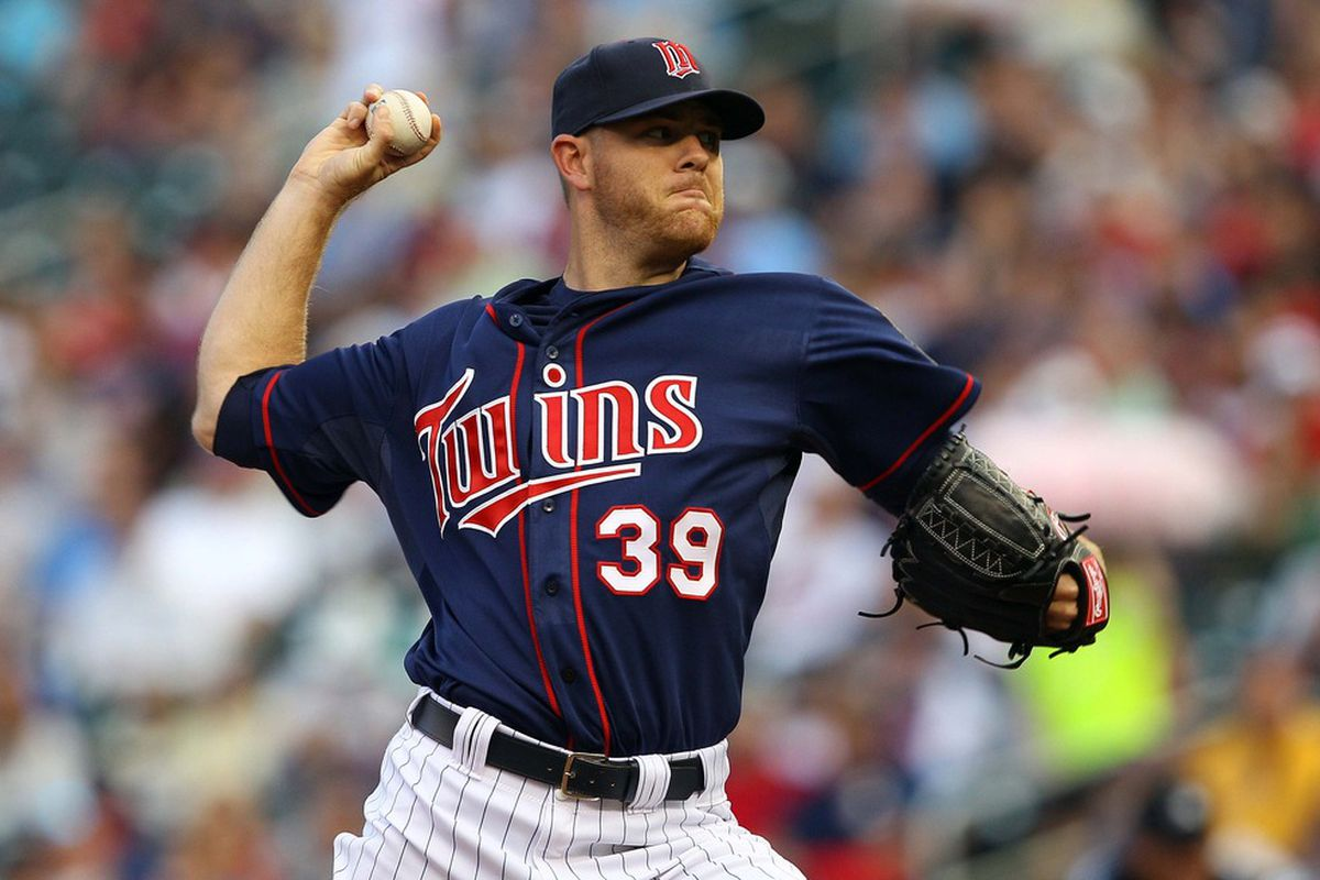 June 13, 2012; Minneapolis, MN, USA: Minnesota Twins starting pitcher P.J. Walters (39) delivers a pitch in the first inning against the Philadelphia Phillies at Target Field. Mandatory Credit: Jesse Johnson-US PRESSWIRE