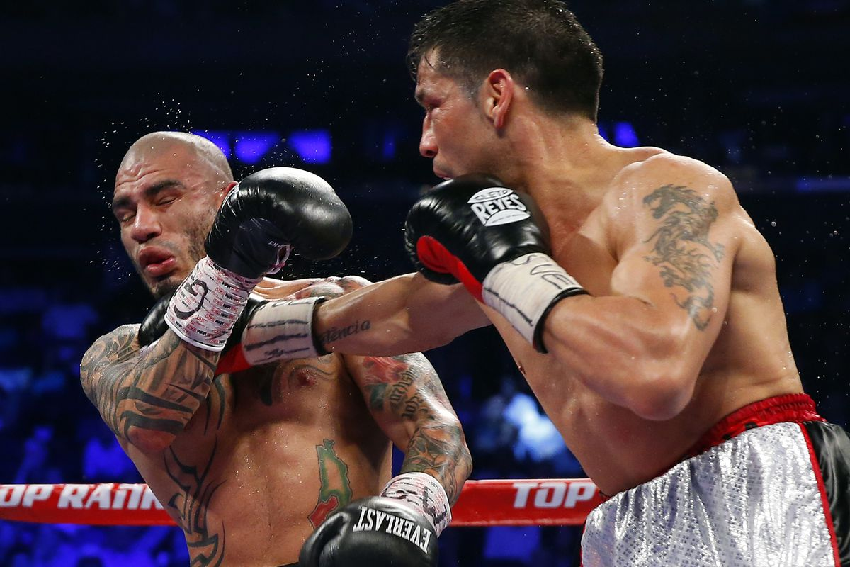 Miguel Cotto (L) of Puerto Rico, is hit in the jaw by a right hand punch by Sergio Martinez of Argentina during the eighth round as they battle for the WBC Middleweight Championship on June 7, 2014 at Madison Square Garden in New York City