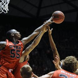 Utah Utes guard Delon Wright (55) tips a rebound away during a game at the Jon M. Huntsman Center on Saturday, Dec. 14, 2013.