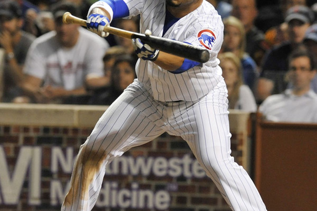 Carlos Pena of the Chicago Cubs bunts for a base hit against the Atlanta Braves at Wrigley Field in Chicago, Illinois.  (Photo by David Banks/Getty Images)