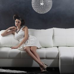 """She may spend a lot of time on her sofa, but she can still be stylish. Image via <a href=""""http://www.shutterstock.com"""">Shutterstock</a>."""