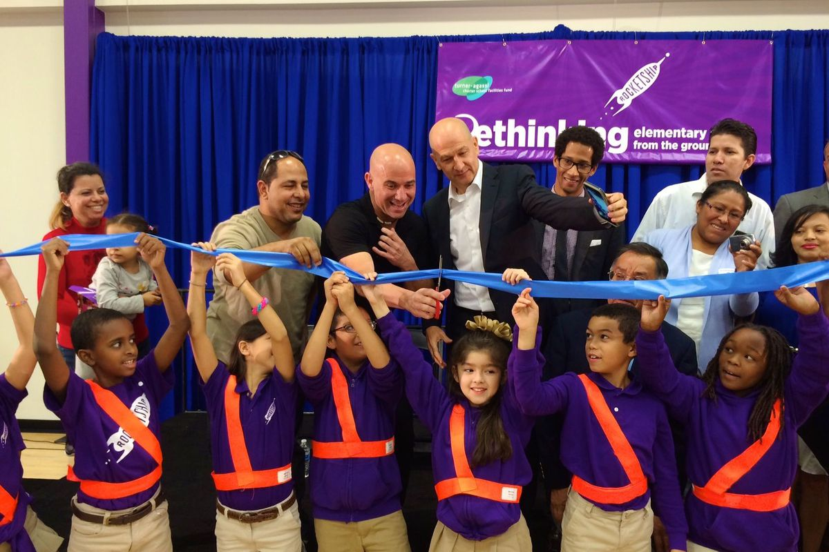 Tennis great Andre Agassi cuts the ribbon as business partner Bobby Turner watches during the official opening last October of Rocketship's newest Nashville charter school.