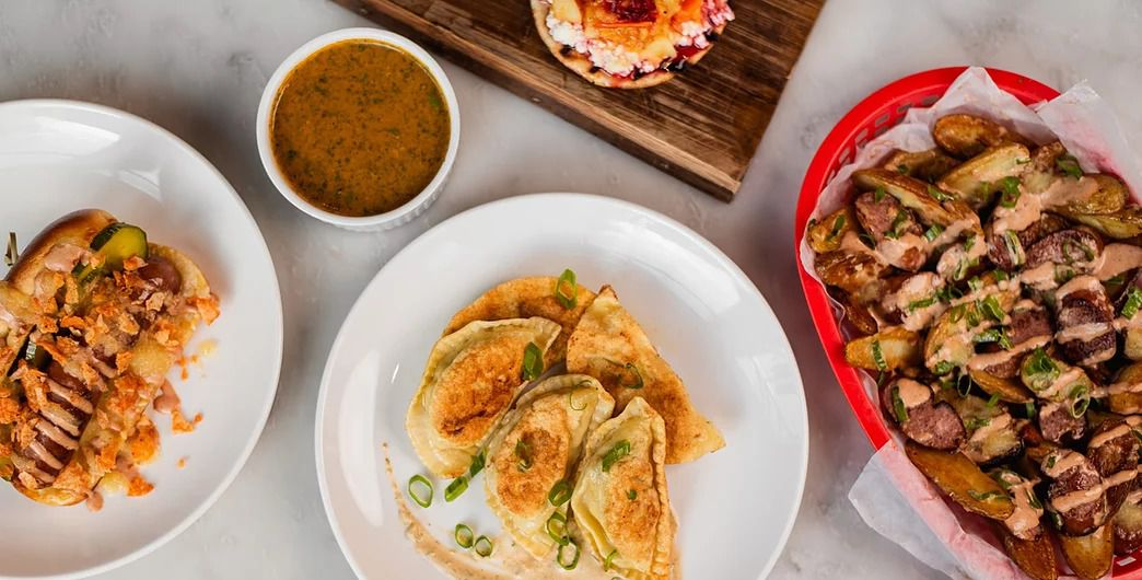 Multiple Polish-Colombian dishes spread out on a counter.