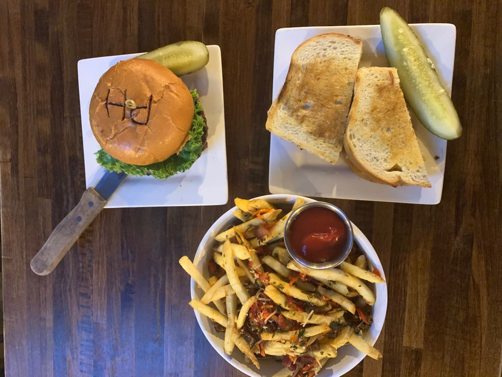 A Pacific House burger, tombo tuna sandwich and dirty fries at Pacific House