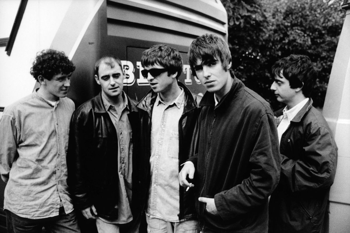 Oasis the band poses in London.