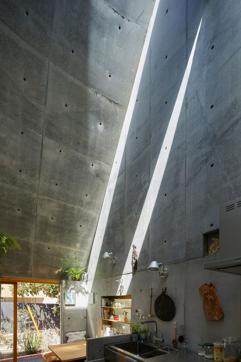 Light casting down concrete walls