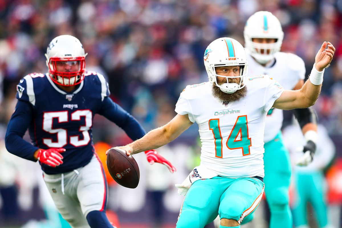 Ryan Fitzpatrick #14 of the Miami Dolphins runs the ball in the third quarter of a game against the New England Patriots at Gillette Stadium on December 29, 2019 in Foxborough, Massachusetts.
