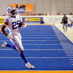 Brigham Young Cougars running back Tyler Allgeier (25) runs into the end zone for a touchdown as BYU and Boise State play a college football game at Albertsons Stadium in Boise on Friday, Nov. 6, 2020. BYU won 51-17.