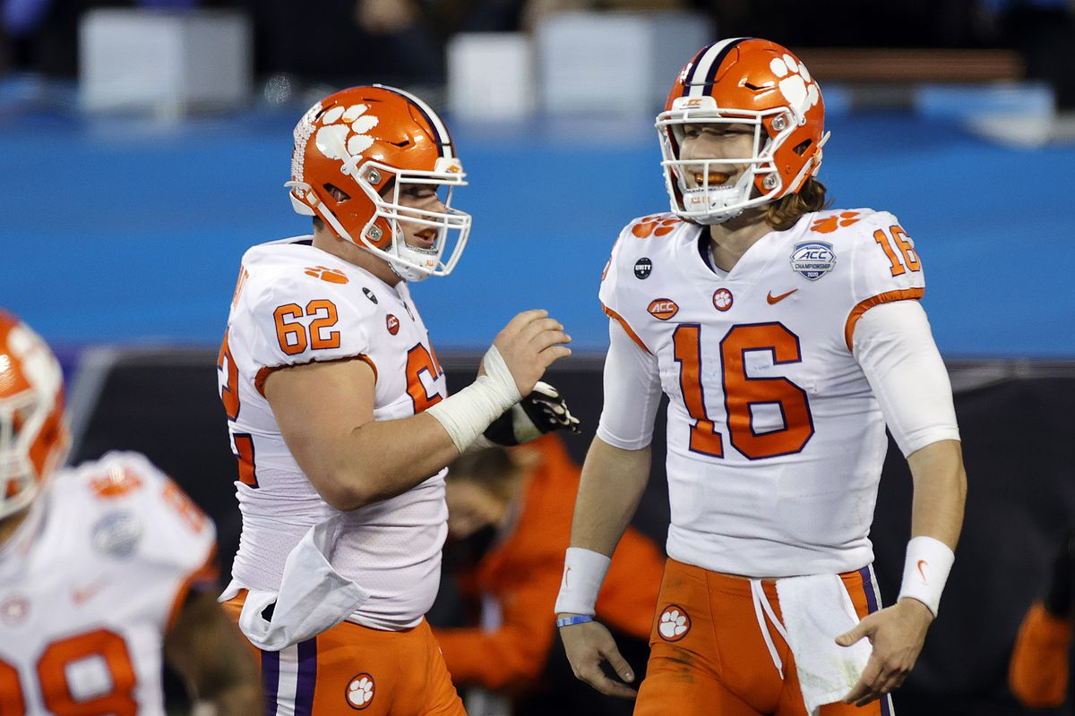 Quarterback Trevor Lawrence of the Clemson Tigers celebrates with teammates after scoring a 34-yard rushing touchdown in the third quarter against the Notre Dame Fighting Irish during the ACC Championship game at Bank of America Stadium on December 19, 2020 in Charlotte, North Carolina.