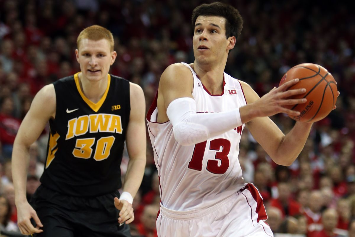 Duje Dukan of Wisconsin blows by Iowa's Aaron White in the Badgers' 82-53 victory