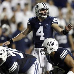 Brigham Young Cougars quarterback Taysom Hill (4) runs the wildcat against Washington State in Provo  Thursday, Aug. 30, 2012.