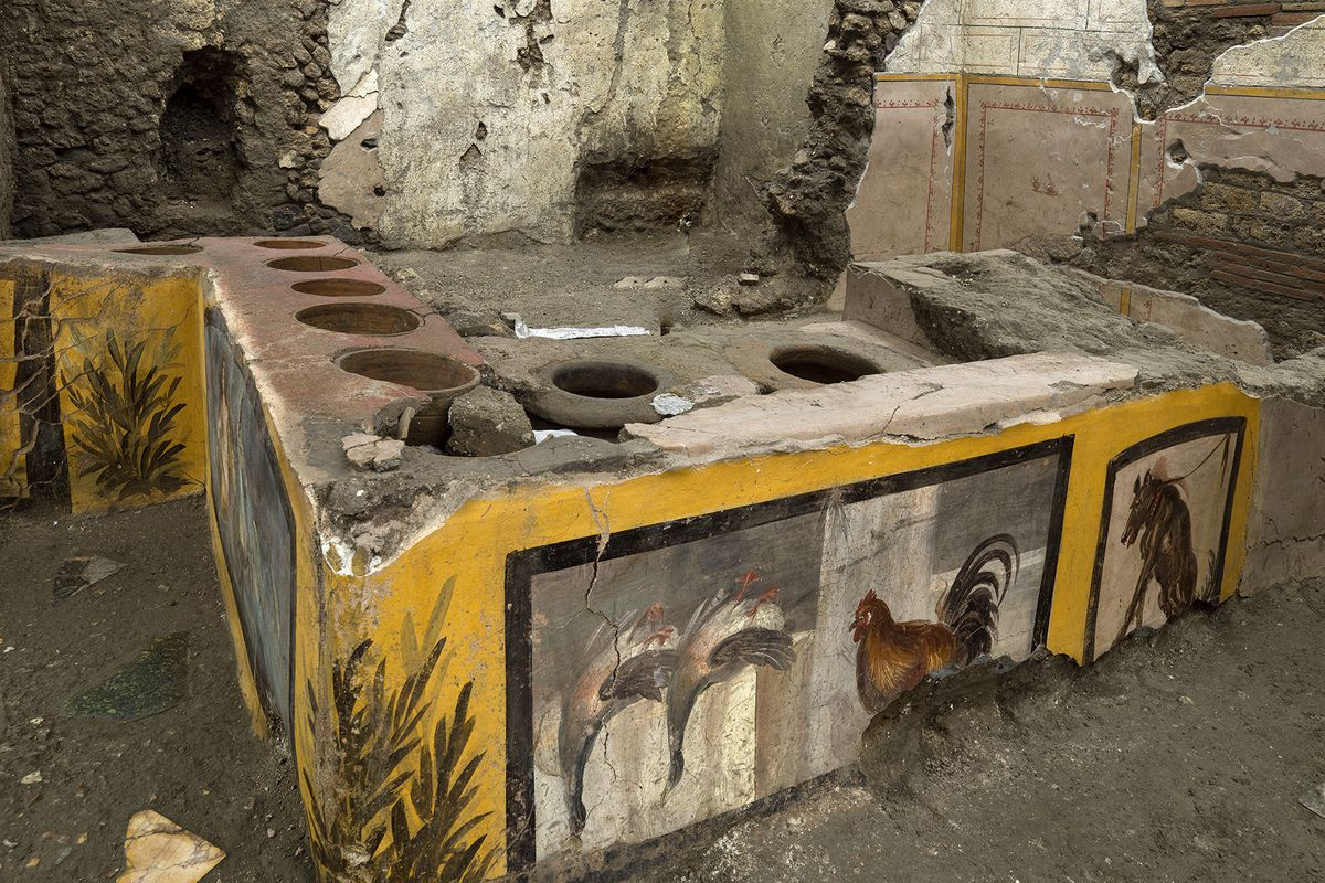 A photo made available by the Pompeii Archeological park press office shows the thermopolium in the Pompeii archeological park, near Naples, Italy. A fast-food eatery discovered at Pompeii is now completely excavated, helping to reveal some favorite dishes of citizens of the ancient Roman city who liked to eat out.