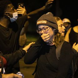 The girlfriend of Anthony Huber speaks to protesters during a peaceful march around Kenosha on the fourth day of civil unrest after police shot Jacob Blake, Wednesday night, Aug. 26, 2020. Huber, 26, of Silver Lake was one of two men shot to death during unrest Tuesday night and Kyle Rittenhouse, 17, has been charged in connection with the homicides.