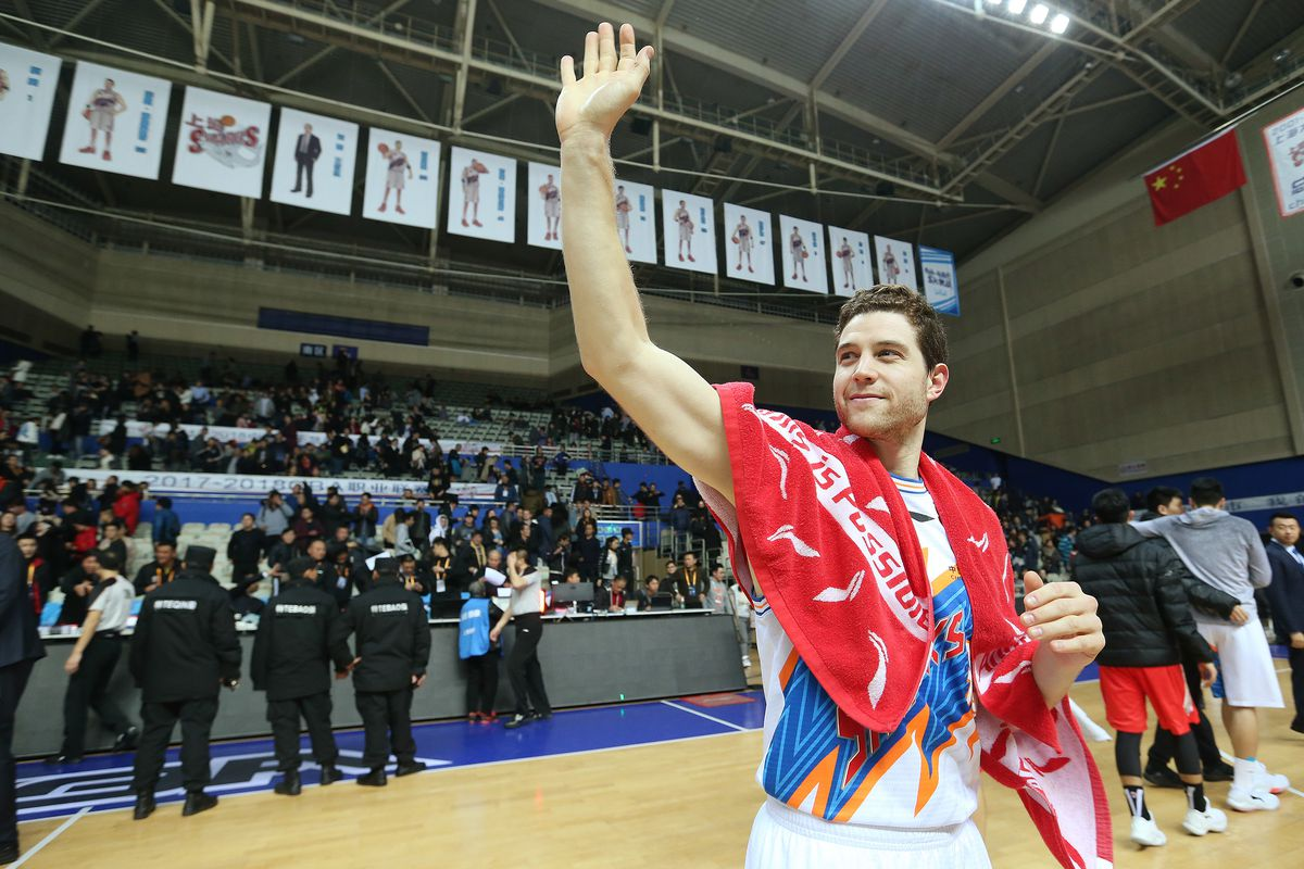 FILE: Jimmer Fredette waves to fans after the game with the Bayi Rockets in Shanghai, China, on Jan 19, 2018.