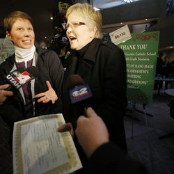 Kody Partridge and her wife, Laurie Wood, talk to the media following their marriage. Hundreds turn out to obtain marriage licenses Friday, Dec. 20, 2013 in the Salt Lake County offices after a federal judge ruled that Amendment 3, Utah's same-sex marriage ban, is unconstitutional.