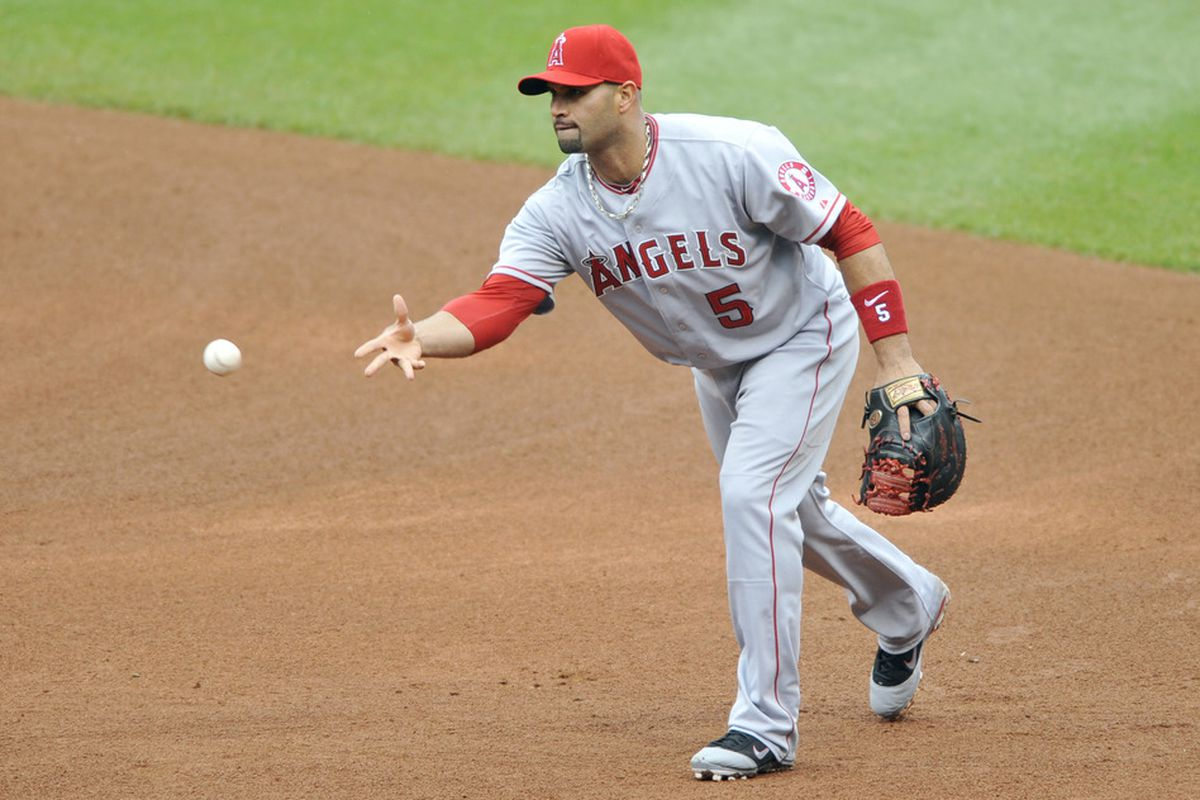 Apr 28, 2012; Cleveland, OH, USA; Los Angeles Angels first baseman Albert Pujols (5) throws to first base in the third inning against the Cleveland Indians at Progressive Field. Mandatory Credit: David Richard-US PRESSWIRE