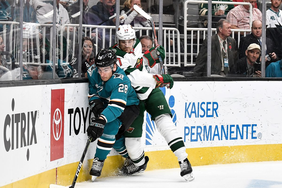 SAN JOSE, CA - NOVEMBER 06: Timo Meier #28 of the San Jose Sharks fights for the puck against Marcus Foligno #17 of the Minnesota Wild at SAP Center on November 6, 2018 in San Jose, California