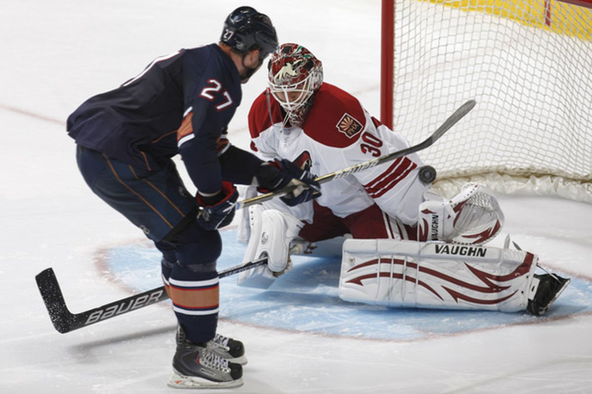 Dustin Penner beats the poke check to score the deciding goal in the shootout against Ilya Bryzgalov of the Phoenix Coyotes.
