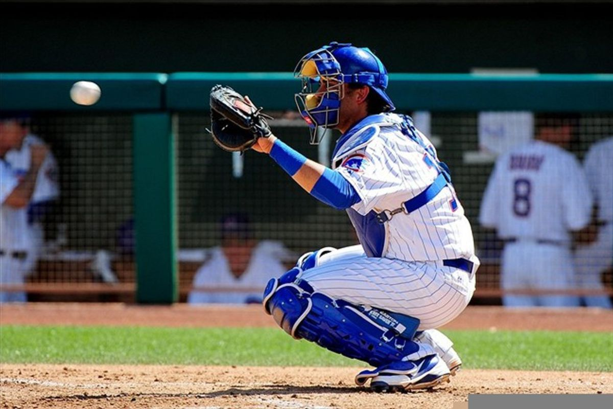 Mar. 14, 2012; Mesa, AZ, USA; Chicago Cubs catcher Geovany Soto (18) catches a pitch prior to the second inning against the Milwaukee Brewers at HoHoKam Park.  Mandatory Credit: Matt Kartozian-US PRESSWIRE
