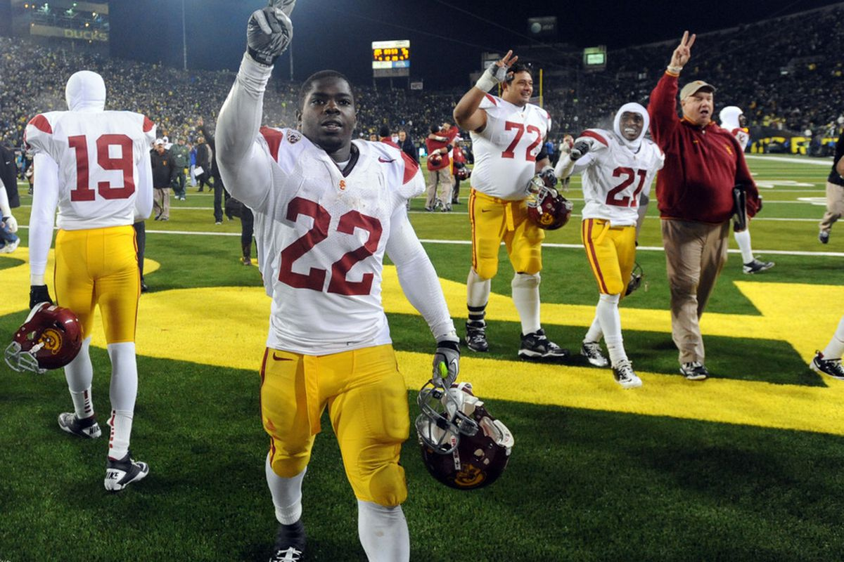 EUGENE, OR - NOVEMBER 19: Running back Curtis McNeal #22 of the USC Trojans celebrates after the Trojans upset the Oregon Ducks at Autzen Stadium on November 19, 2011 in Eugene, Oregon. USC won the game 38-35. (Photo by Steve Dykes/Getty Images)