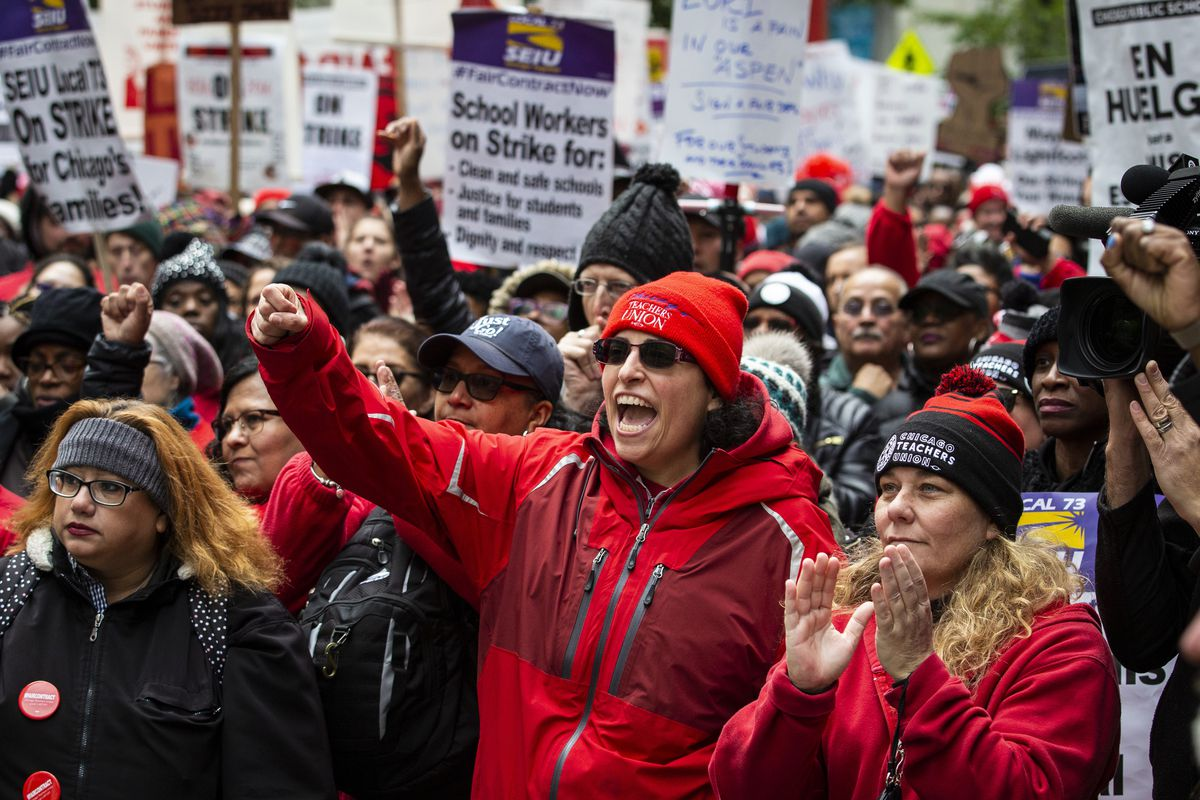 Thousands of striking Chicago Teachers Union members and supporters rally at the Thompson Center after a march on City Hall on Oct. 23, 2019.