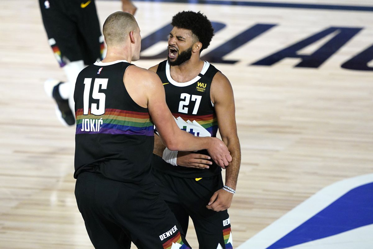 Jamal Murray and Nikola Jokic Denver Nuggets react during overtime of an NBA basketball first-round playoff game at The Field House at ESPN Wide World Of Sports Complex on August 17, 2020 in Lake Buena Vista, Florida.