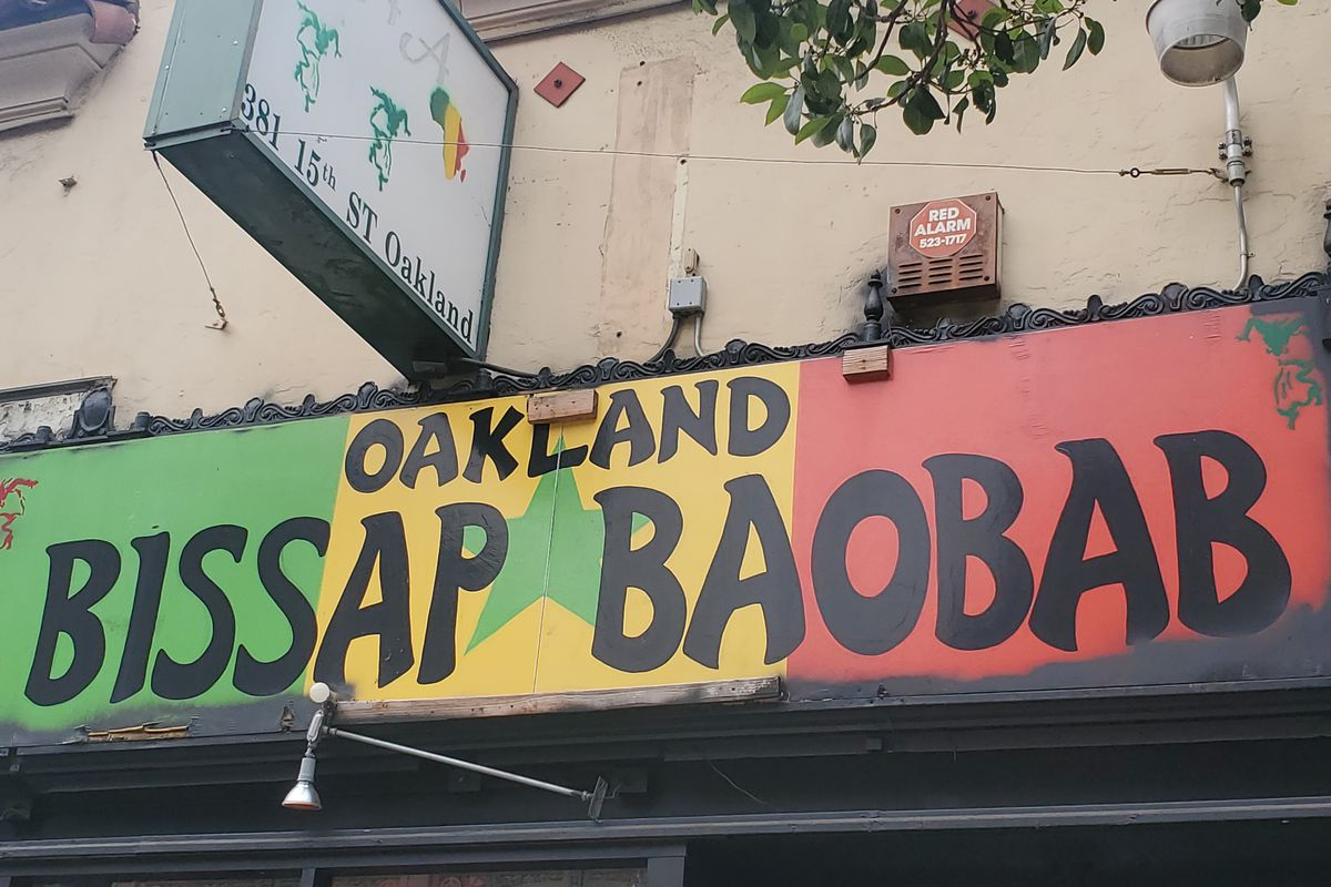 The exterior sign of Baobab Oakland, in green, yellow, and red