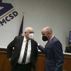 Ray Timothy, executive director of the Utah Education Network, left, and Gov. Spencer Cox greet one another prior to a press conference at the Murray City School District office on Thursday, Jan.14, 2021. The district is the first in the nation to create and launch its own wireless broadband network for students.