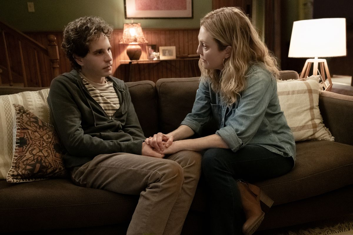 Evan and Evan's mom sit on a couch in Dear Evan Hansen